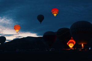 Hot air balloons taking off before day break