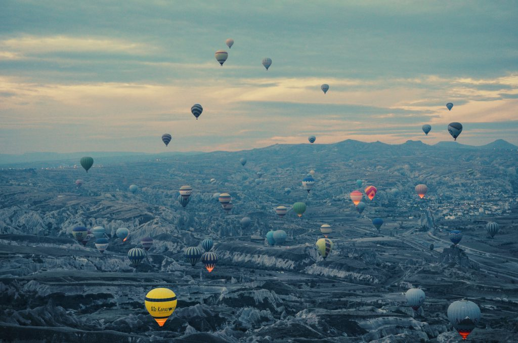 Hot air balloons flying over Kapadokya